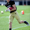 """Dustin Ebner takes off with a catch during Spring drills on Sunday.<br /> For more photos and videos of CU football, go to  <a href=""""http://www.dailycamera.com"""">http://www.dailycamera.com</a>.<br /> Cliff Grassmick / March 18, 2012"""