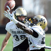 "Richard Yates, left, and Harrison Hunter go through defensive back drills on Sunday.<br /> For more photos and videos of CU football, go to  <a href=""http://www.dailycamera.com"">http://www.dailycamera.com</a>.<br /> Cliff Grassmick / March 18, 2012"