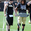 "Nick Hirschman, left, and Daniel Munyer at Spring drills on Sunday.<br /> For more photos and videos of CU football, go to  <a href=""http://www.dailycamera.com"">http://www.dailycamera.com</a>.<br /> Cliff Grassmick / March 18, 2012"