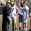 """CU coach Eric Kiesau works with QB's Cody Hawkins, Nick Hirschman and Tyler Hansen, on Saturday.<br /> For more football photos, go to photo galleries at  <a href=""""http://www.dailycamera.com"""">http://www.dailycamera.com</a>.<br /> Cliff Grassmick / March 6, 2010"""
