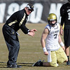 "CU coach Dan Hawkins with son, Cody, during spring drills.<br /> For more football photos, go to photo galleries at  <a href=""http://www.dailycamera.com"">http://www.dailycamera.com</a>.<br /> Cliff Grassmick / March 6, 2010"