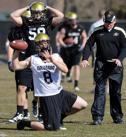 "Nick Hirschman and coach Dan Hawkins during spring practice.<br /> For more football photos, go to photo galleries at  <a href=""http://www.dailycamera.com"">http://www.dailycamera.com</a>.<br /> Cliff Grassmick / March 6, 2010"