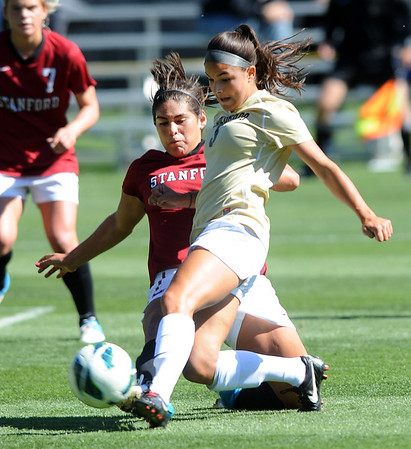 "Olivia Pappalardo of CU, takes a shot with Alina Garciamendez, of Stanford, defending.<br /> For more photos of the game, go to  <a href=""http://www.dailycamera.com"">http://www.dailycamera.com</a>.<br /> Cliff Grassmick  / October 7, 2012"