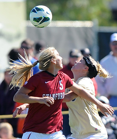 "Courtney Verloo, left, of Stanford, and Amy Barczuk of CU, try to connect with the ball.<br /> For more photos of the game, go to  <a href=""http://www.dailycamera.com"">http://www.dailycamera.com</a>.<br /> Cliff Grassmick  / October 7, 2012"