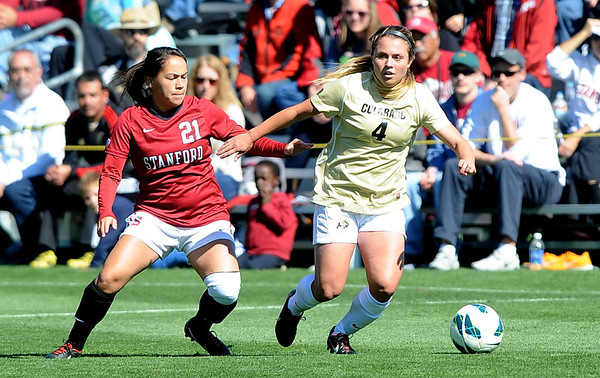 """Madison Krauser (4) of CU works around Loeau LaBonta of Stanford<br /> For more photos of the game, go to  <a href=""""http://www.dailycamera.com"""">http://www.dailycamera.com</a>.<br /> Cliff Grassmick  / October 7, 2012"""