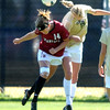 "Nina Watkins, left,  of Stanford, and Lizzy Herzl of CU, hit with their heads.<br /> For more photos of the game, go to  <a href=""http://www.dailycamera.com"">http://www.dailycamera.com</a>.<br /> Cliff Grassmick  / October 7, 2012"