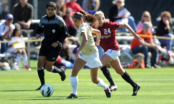 "Olivia Pappalardo of CU, takes off past Alex Doll of Stanford.<br /> For more photos of the game, go to  <a href=""http://www.dailycamera.com"">http://www.dailycamera.com</a>.<br /> Cliff Grassmick  / October 7, 2012"