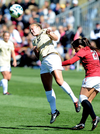 "Carly Bolyard, left, of CU, hits past Loeau LaBonta of Stanford.<br /> For more photos of the game, go to  <a href=""http://www.dailycamera.com"">http://www.dailycamera.com</a>.<br /> Cliff Grassmick  / October 7, 2012"