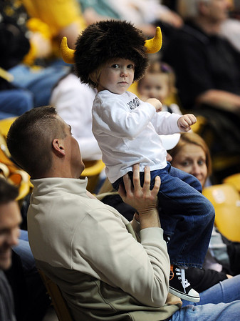 "Jason Cooper holds up his son, Jonathan, 2, to cheer on the Buffs Thursday night.<br /> For more photos of the game, go to  <a href=""http://www.dailycamera.com"">http://www.dailycamera.com</a>.<br /> Cliff Grassmick / March 17, 2011"