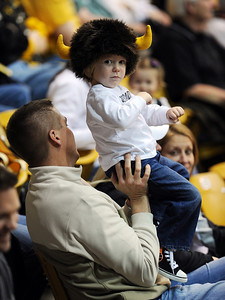 Jason Cooper holds up his son, Jonathan, 2, to cheer on the Buffs Thursday night. For more photos of the game, go to www.dailycamera.com. Cliff Grassmick / March 17, 2011
