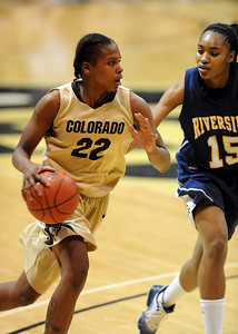 Brittany Spears of CU drives on Brittany Waddell during the second half of the March 17, 2011 WNIT game in Boulder, Colo. For more photos of the game, go to www.dailycamera.com. Cliff Grassmick / March 17, 2011