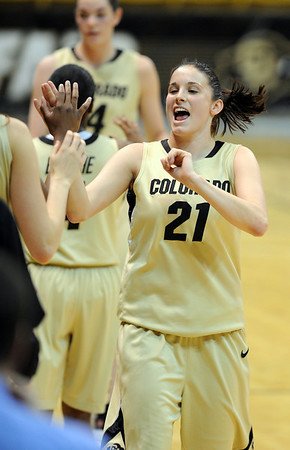 "Chelsea Dale gets a bunch of high fives after coming out late in the CU win.<br /> For more photos of the game, go to  <a href=""http://www.dailycamera.com"">http://www.dailycamera.com</a>.<br /> Cliff Grassmick / March 17, 2011"
