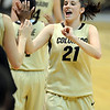 """Chelsea Dale gets a bunch of high fives after coming out late in the CU win.<br /> For more photos of the game, go to  <a href=""""http://www.dailycamera.com"""">http://www.dailycamera.com</a>.<br /> Cliff Grassmick / March 17, 2011"""