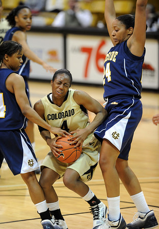 "Britney Blythe of CU is trapped  by Tre'shonti Nottingham, left, and Rhaya Neabors of UC Riverside during the second half of the March 17, 2011 WNIT game in Boulder, Colo.<br /> For more photos of the game, go to  <a href=""http://www.dailycamera.com"">http://www.dailycamera.com</a>.<br /> Cliff Grassmick / March 17, 2011"