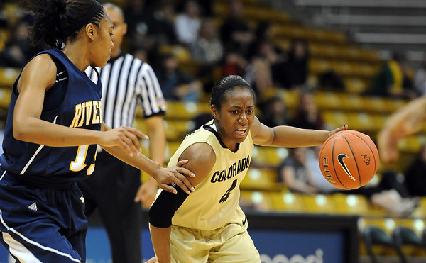 """Britney Blythe of CU tries to get around Brittany Waddell of UC Riverside during the first half of the March 17, 2011 WNIT game in Boulder, Colo.<br /> For more photos of the game, go to  <a href=""""http://www.dailycamera.com"""">http://www.dailycamera.com</a>.<br /> Cliff Grassmick / March 17, 2011"""