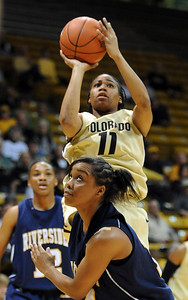 Brittany Wilson of Colorado puts up a shot over Tre'shonti Nottingham of UC-Riverside during the first half of the March 17, 2011 WNIT game in Boulder, Colo. For more photos of the game, go to www.dailycamera.com. Cliff Grassmick / March 17, 2011