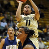"Brittany Wilson of Colorado puts up a shot over Tre'shonti Nottingham of UC-Riverside during the first half of the March 17, 2011 WNIT game in Boulder, Colo.<br /> For more photos of the game, go to  <a href=""http://www.dailycamera.com"">http://www.dailycamera.com</a>.<br /> Cliff Grassmick / March 17, 2011"