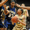 "Chucky Jeffery (23) of Colorado, looks for room against Nicole Anderson (11) and Jazzmin Lewis, both of UC-Riverside during the first half of the March 17, 2011 WNIT game in Boulder, Colo.<br /> For more photos of the game, go to  <a href=""http://www.dailycamera.com"">http://www.dailycamera.com</a>.<br /> Cliff Grassmick / March 17, 2011"