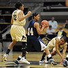 """Ashley Wilson (12) and her sister Brittany, both of CU, try to trap Tre'shonti Nottingham during the first half of the March 17, 2011 WNIT game in Boulder, Colo.<br /> For more photos of the game, go to  <a href=""""http://www.dailycamera.com"""">http://www.dailycamera.com</a>.<br /> Cliff Grassmick / March 17, 2011"""