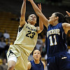 """Chucky Jeffery of CU drives over Nicole Anderson of UC Riverside during the first half of the March 17, 2011 WNIT game in Boulder, Colo.<br /> For more photos of the game, go to  <a href=""""http://www.dailycamera.com"""">http://www.dailycamera.com</a>.<br /> Cliff Grassmick / March 17, 2011"""