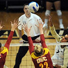 "Neira Ortiz Ruiz of CU hits on Alexis Olgard (1) and Katie Fuller of USC on Saturday night.<br /> For more photos of the game, go to  <a href=""http://www.dailycamera.com"">http://www.dailycamera.com</a>.<br /> Cliff Grassmick / November 10, 2012"