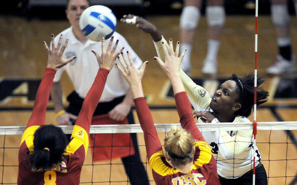 "Alexis Austin of CU hits against USC on Saturday night.<br /> For more photos of the game, go to  <a href=""http://www.dailycamera.com"">http://www.dailycamera.com</a>.<br /> Cliff Grassmick / November 10, 2012"