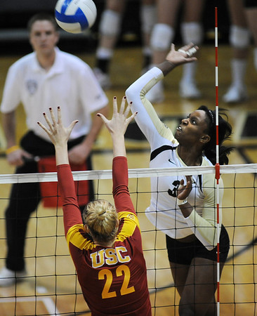 "Alexis Austin of CU hits on Katie Fuller of USC on Saturday night.<br /> For more photos of the game, go to  <a href=""http://www.dailycamera.com"">http://www.dailycamera.com</a>.<br /> Cliff Grassmick / November 10, 2012"