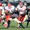 "Donta Abron of CU gets past the big guys of Utah for a positive run.<br /> For more photos of the CU game, go to  <a href=""http://www.dailycamera.com"">http://www.dailycamera.com</a><br /> Cliff Grassmick / November 23, 2012"