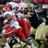 "Tyler  Hennington of CU pulls down John White of Utah.<br /> For more photos of the CU game, go to  <a href=""http://www.dailycamera.com"">http://www.dailycamera.com</a><br /> Cliff Grassmick / November 23, 2012"