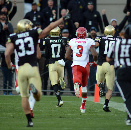 """Marques Mosley of CU  runs a kick off back for a touchdown on this play against Utah on Friday.<br /> For more photos of the CU game, go to  <a href=""""http://www.dailycamera.com"""">http://www.dailycamera.com</a><br /> Cliff Grassmick / November 23, 2012"""