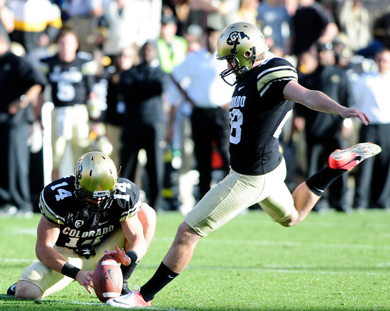 University of Colorado's Will Oliver (28) makes an extra point during CU's game against Utah on Folsom Field in Boulder on Friday Nov. 23, 2012. DAILY CAMERA/ JESSICA CUNEO.