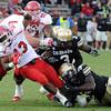 "Childera Uzo-Diribe, bottom, gets a hols of Kelvin York of Utah.<br /> For more photos of the CU game, go to  <a href=""http://www.dailycamera.com"">http://www.dailycamera.com</a><br /> Cliff Grassmick / November 23, 2012"