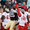 "Gerald Thomas (25) of CU tries to catch a long ball behind Ryan Lacy of Utah.<br /> For more photos of the CU game, go to  <a href=""http://www.dailycamera.com"">http://www.dailycamera.com</a><br /> Cliff Grassmick / November 23, 2012"