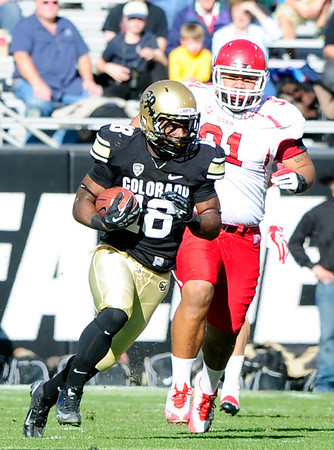 112312 CU football0035.JPG University of Colorado's Donta Abron (18) runs the ball and is chased by Tenny Palepoi (91) during their game against Utah on Folsom Field in Boulder on Friday Nov. 23, 2012. DAILY CAMERA/ JESSICA CUNEO.
