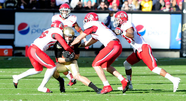 University of Colorado's Tyler McCulloch (87) gets tackled during CU's game against Utah on Folsom Field in Boulder on Friday Nov. 23, 2012. DAILY CAMERA/ JESSICA CUNEO.