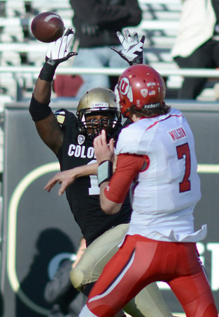 "Derrick Webb of CU tries to knock down a pass by Travis Wilson of Utah.<br /> For more photos of the CU game, go to  <a href=""http://www.dailycamera.com"">http://www.dailycamera.com</a><br /> Cliff Grassmick / November 23, 2012"