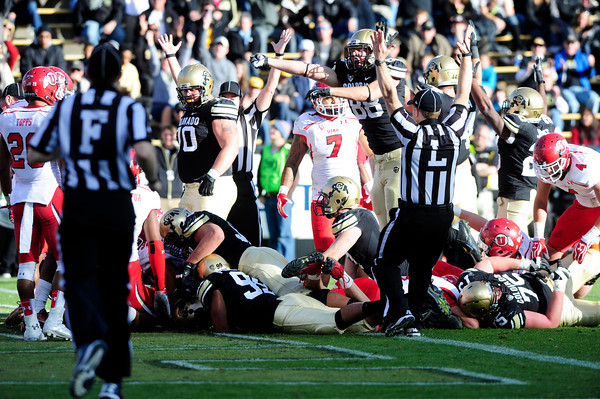University of Colorado celebrates after scoring a touchdown during their game against Utah on Folsom Field in Boulder on Friday Nov. 23, 2012. DAILY CAMERA/ JESSICA CUNEO.