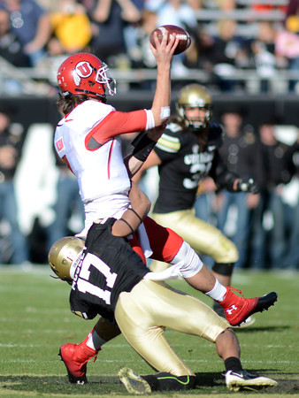 "Marques Mosley of CU tries to wrap up Travis Wilson of Utah before he gets the pass off.<br /> For more photos of the CU game, go to  <a href=""http://www.dailycamera.com"">http://www.dailycamera.com</a><br /> Cliff Grassmick / November 23, 2012"