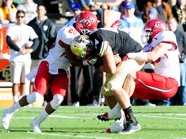University of Colorado's Nick Kasa (44) gets tackled by Reggie Topps (28) and Jason Whittingham (53) during their game against Utah on Folsom Field in Boulder on Friday Nov. 23, 2012. DAILY CAMERA/ JESSICA CUNEO.