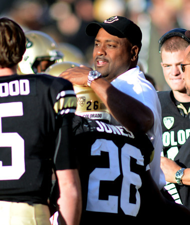 "CU coach, Jon Embree, gives Tony Jones some love after a TD run.<br /> For more photos of the CU game, go to  <a href=""http://www.dailycamera.com"">http://www.dailycamera.com</a><br /> Cliff Grassmick / November 23, 2012"