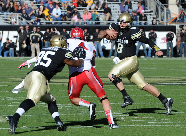 "CU QB, Nick Hirschman, tries to run to the endzone against Urah.<br /> For more photos of the CU game, go to  <a href=""http://www.dailycamera.com"">http://www.dailycamera.com</a><br /> Cliff Grassmick / November 23, 2012"