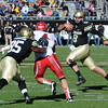 "CU QB, Nick Hirschman, tries to run to the endzone against Urah.<br /> For more photos of the CU game, go to  <a href=""http://www.dailycamera.com"">http://www.dailycamera.com</a><br /> Cliff Grassmick / November 23, 2012"