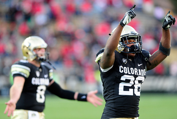 University of Colorado's Nick Hirschman (8) and Tony Jones (26) celebrate after a touchdown during their game against Utah on Folsom Field in Boulder on Friday Nov. 23, 2012. DAILY CAMERA/ JESSICA CUNEO.
