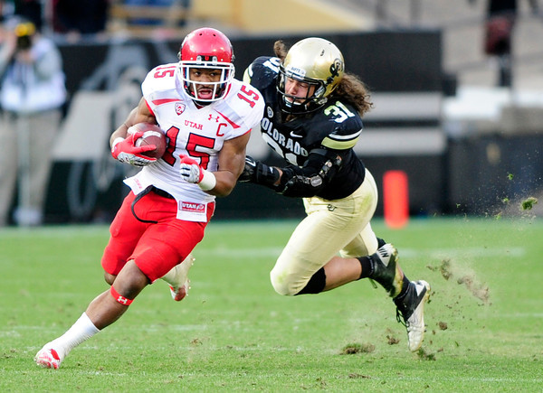 University of Colorado's Jon Major (31) dives after John White (15) during their game against Utah on Folsom Field in Boulder on Friday Nov. 23, 2012. DAILY CAMERA/ JESSICA CUNEO.