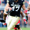 University of Colorado's Alex Wood (47) runs the ball during CU's game against Utah on Folsom Field in Boulder on Friday Nov. 23, 2012. DAILY CAMERA/ JESSICA CUNEO.