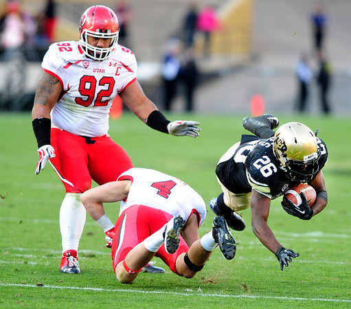 112312 CU football0974.jpg University of Colorado's John Walker (26) is upended by Brian Blechen after making a reception during their game against Utah on Folsom Field in Boulder on Friday Nov. 23, 2012. DAILY CAMERA/ JESSICA CUNEO.