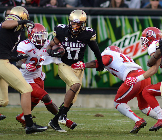 """Marques Mosley of CU  runs a kick off back against Utah on Friday.<br /> For more photos of the CU game, go to  <a href=""""http://www.dailycamera.com"""">http://www.dailycamera.com</a><br /> Cliff Grassmick / November 23, 2012"""