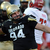 "Tyler  Hennington of CU celebrates a tackle for a loss on John White of Utah on Friday.<br /> For more photos of the CU game, go to  <a href=""http://www.dailycamera.com"">http://www.dailycamera.com</a><br /> Cliff Grassmick / November 23, 2012"