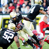 University of Colorado's Donta Abron (18) runs the ball as Nick Kasa (44) blocks him during their game against Utah on Folsom Field in Boulder on Friday Nov. 23, 2012. DAILY CAMERA/ JESSICA CUNEO.
