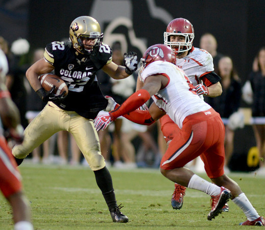 """Nelson Spruce of CU, looks for room to run against Utah.<br /> For more photos of the CU game, go to  <a href=""""http://www.dailycamera.com"""">http://www.dailycamera.com</a><br /> Cliff Grassmick / November 23, 2012"""